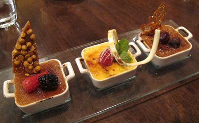Trio of Creme Brulee: butterscotch, white chocolate-raspberry, and milk chocolate-hazelnut.