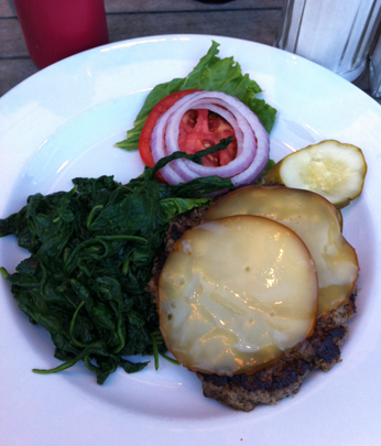 Bun-less Turkey Burger with Smoked Gouda and a  side of sauteed spinach