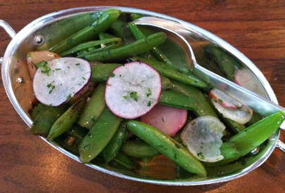 Sugar snap peas with radishes, farm butter and herbs
