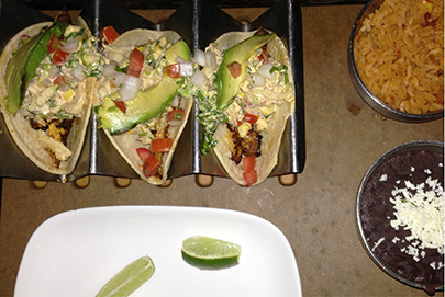 Baja tacos with grilled market fish, Mexican slaw, tomato, corn, avocado and chipotle aioli