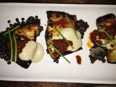 Spiced eggplant, accompanied by harissa, black lentils and garlic tehina