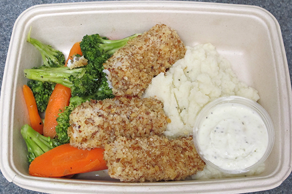 Almond crusted fish sticks with cauliflower mash, broccoli and carrots